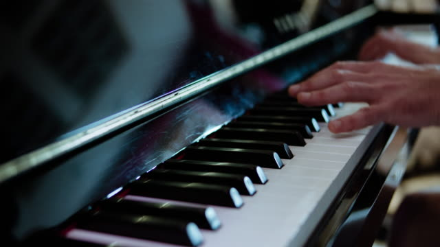 piano player playing his composition.  professional recorded sound. - piano stock videos & royalty-free footage