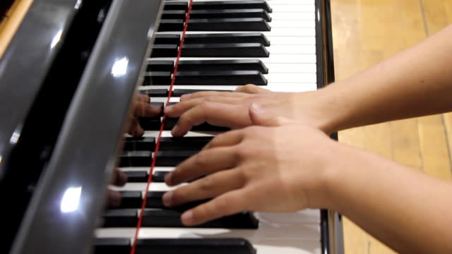 piano player (hd) - musical symbol stock videos & royalty-free footage
