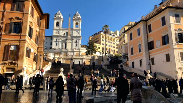 piazza di spagna, at the bottom of the spanish steps, is one of the most famous squares in rome italy - rome italy stock videos & royalty-free footage