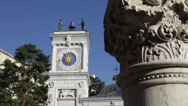Piazza Libertà in Udine with close up on the clock