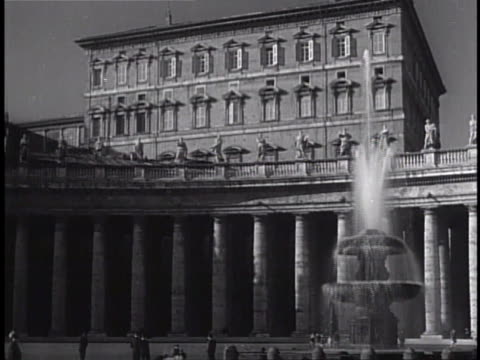 Piazza San Pietro colonnade topped w/ statues of saints fountain FG