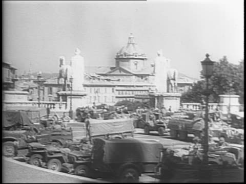 piazza venezia sign / crowd cheers as soldier mocks mussolini on a balcony / general mark clark enters rome in a jeep and crowds swarm him /... - benito mussolini stock videos & royalty-free footage