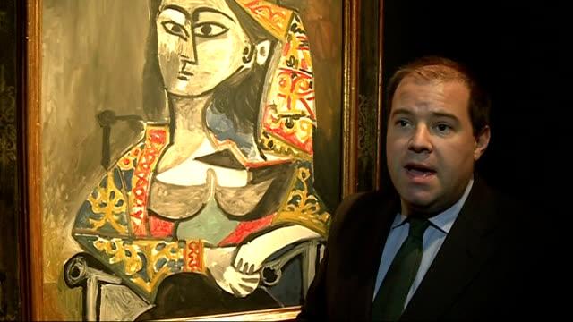 Picasso artwork at Christies auction ENGLAND London Christie INT Jay Vincze interview SOT / 'Femme au costume turc dans un fauteuil' Picasso...