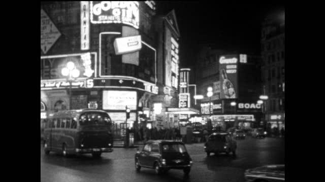 piccadilly circus at night with neon signs and traffic; 1967 - brightly lit stock videos & royalty-free footage