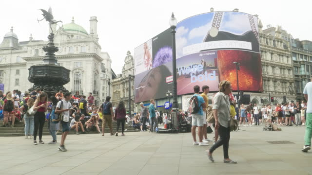 ws piccadilly circus billboard and eros - electronic billboard stock videos and b-roll footage