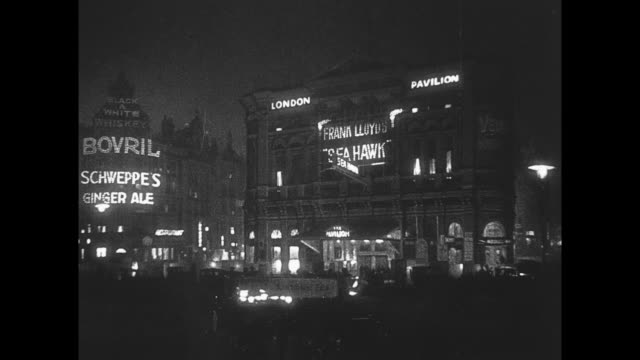 1925 piccadilly circus lit up at night - 1925 stock videos & royalty-free footage