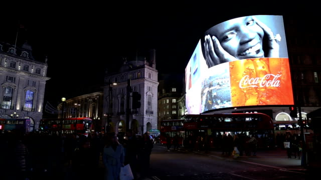 piccadilly circus london in the night - commercial sign stock videos & royalty-free footage