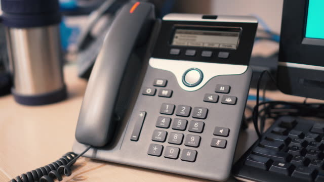 pick up telephone, answer the phone - ip phone - sollevare video stock e b–roll