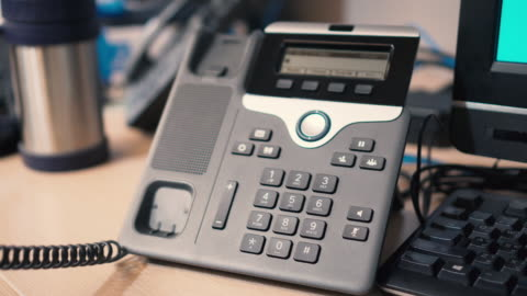 pick up telephone press number to dial call - ip phone - picking up stock videos & royalty-free footage