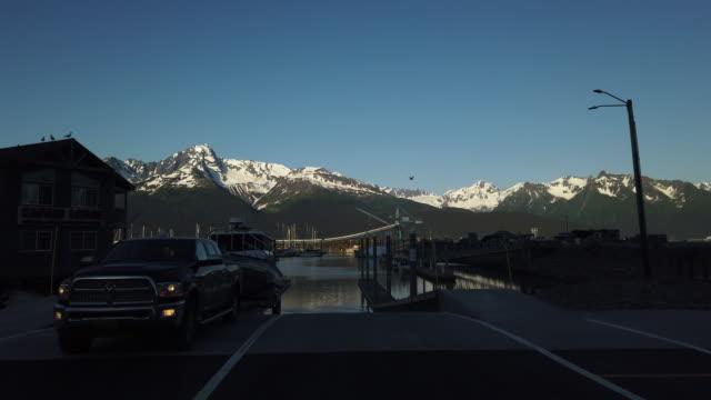 pick up truck towing boat leaving boat ramp, seward, alaska at sunset - boat ramp stock videos & royalty-free footage