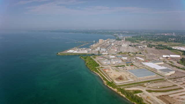 aerial pickering nuclear generating station on the shore of lake ontario, canada - ontario canada stock videos & royalty-free footage
