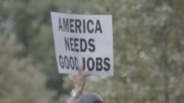 picket signs being carried through city street. - us politics stock videos & royalty-free footage