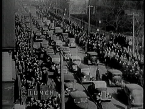 stockvideo's en b-roll-footage met montage 20000 picketers marching along the street / flint michigan united states - 1937