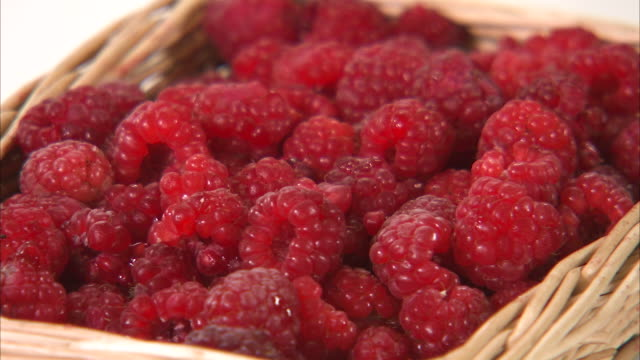 picking raspberries on a basket - brambleberry stock videos & royalty-free footage