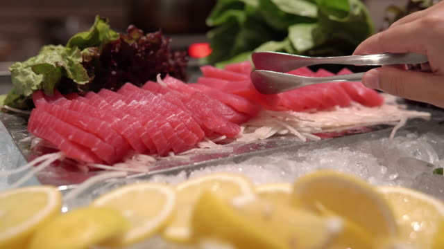 picking sashimi buffet line, japanese food. - convenience food stock videos and b-roll footage