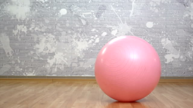 picking up a fitness ball in gym - fitness ball stock videos & royalty-free footage