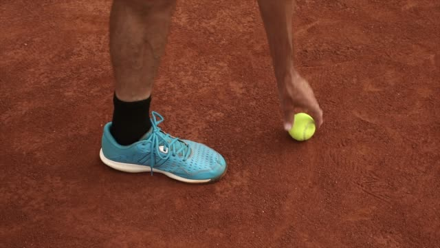 picking up a tennis ball on red clay court - court stock videos & royalty-free footage