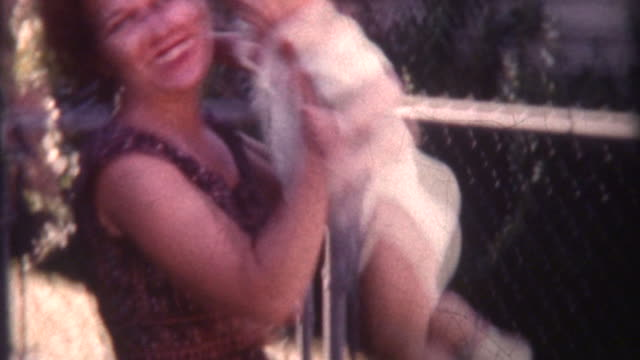 vídeos de stock e filmes b-roll de levantar bebé e sorridente 1958 - film moving image