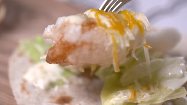 picking up fried shrimp with fork - taco stock videos & royalty-free footage