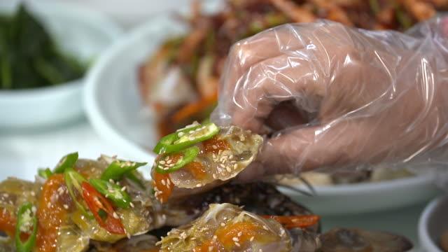 picking up ganjang gejang(soy sauce marinated raw crab) with hand - marinated stock videos and b-roll footage