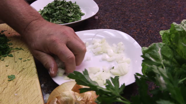 picking up handful of chopped onions cu - wiese stock videos & royalty-free footage