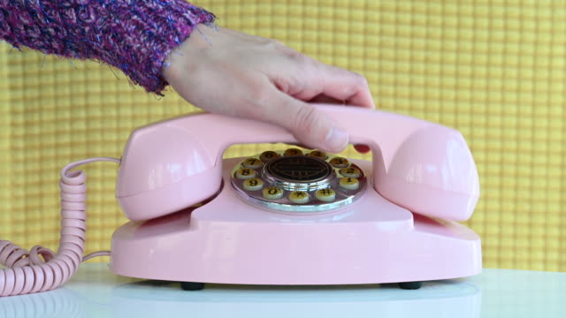 picking up pink retro phone - telephone dial stock videos & royalty-free footage