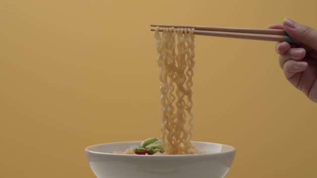 picking up ramyun noodles with chopsticks - spice stock videos & royalty-free footage