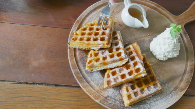 picking waffles on wood plate - waffle iron stock videos and b-roll footage