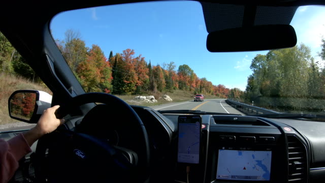 pickup on countryside road with autumn colors and trees - sports utility vehicle stock videos & royalty-free footage