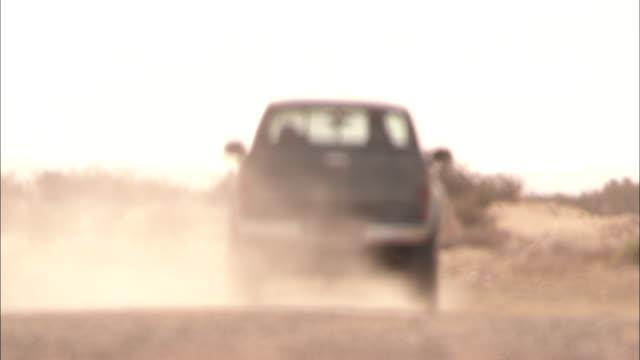 a pickup truck drives through a hot desert landscape. - desert stock videos & royalty-free footage