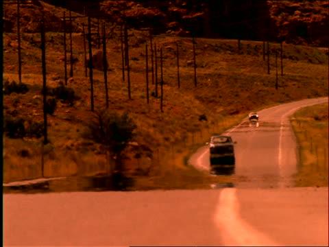 pickup truck driving in heat waves on country road / southwest us - südwestliche bundesstaaten der usa stock-videos und b-roll-filmmaterial