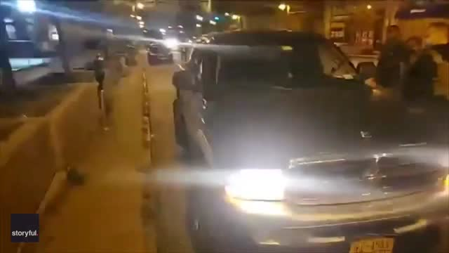pickup truck ran into a protester while driving through a crowd in buffalo, new york on september 23. the crowd was demonstrating against the... - https stock-videos und b-roll-filmmaterial