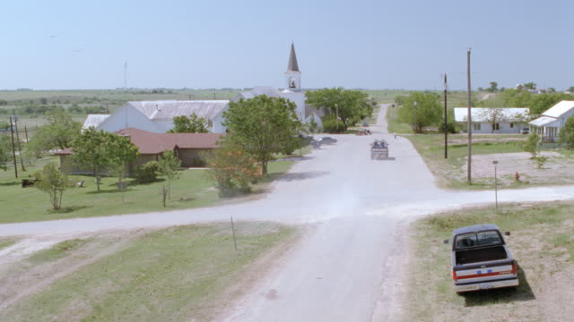 a pickup truck travels along a dusty street past a church. - 1998 stock videos & royalty-free footage