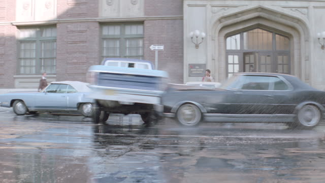 a pickup truck with an obscene bumper sticker pulls forward, and a 1970's sedan collides with it. - entrare in collisione video stock e b–roll