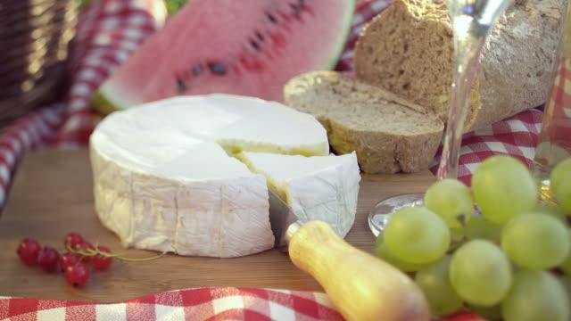 picnic basket on meadow. - hamper stock videos & royalty-free footage