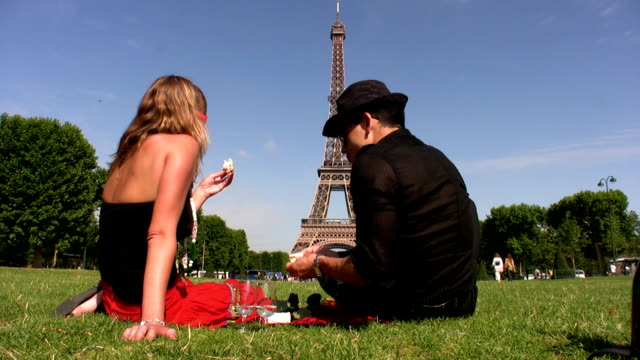 picnic in front the eiffel tower - eiffel tower stock videos and b-roll footage