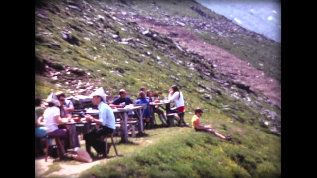 1971 picnic on jura mountain in swiss alps - home movie stock videos & royalty-free footage