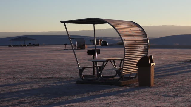 MS PAN Picnic shelters in White Sands National Monument at sunset / Alamogordo, New Mexico, United States