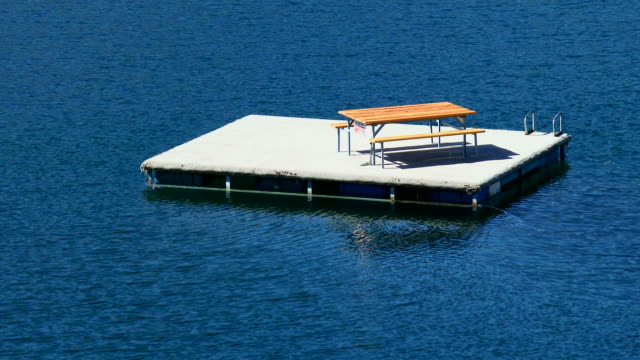 A picnic table on a floating dock on Willowa Lake in eastern Oregon