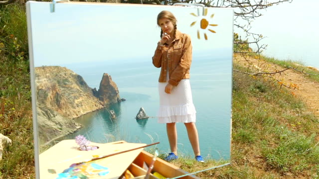 picture - girl on the background of a sea landscape