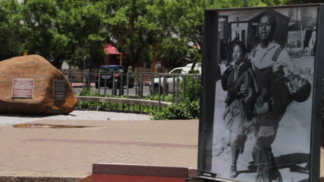 vídeos de stock e filmes b-roll de a picture of hector pieterson being carried after shot by south african police during the soweto uprising / hector pieterson museum - soweto