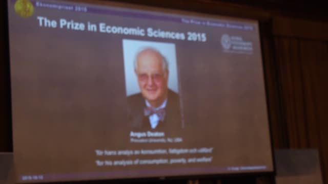 stockvideo's en b-roll-footage met a picture of professor angus deaton winner of the 2015 nobel prize in economic sciences is seen on a screen as goran k hansson permanent secretary... - universitair docent