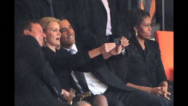 A picture showing Denmarks Prime minister Helle Thorning Schmidt holding up her smartphone with Obama lending a helping hand and posing for a picture...