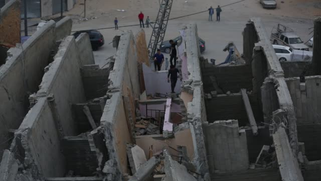 a picture taken on may 6 shows a building in gaza city that was destroyed during israeli airstrikes on gaza city - luftangriff stock-videos und b-roll-filmmaterial