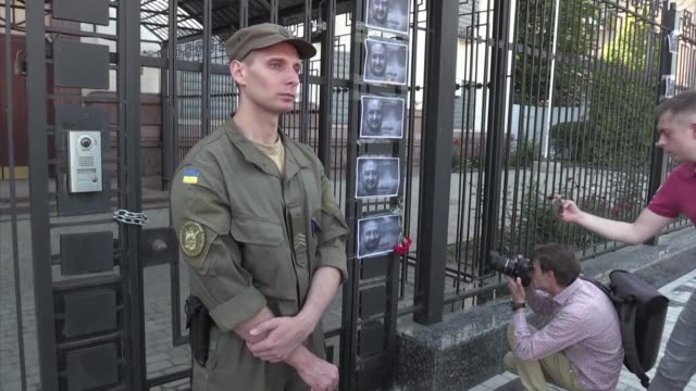 Pictures of murdered Russian journalist Arkady Babchenko have been taped to the Russian Embassy fence