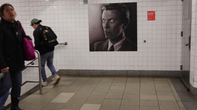 Pictures of rock legend Davis Bowie line the walls of a New York City subway station on April 25 2018 in New York City Besides concert photos and...