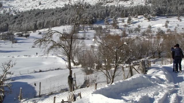 picturesque mountain village covered by snow agains a blue sky - pavel gospodinov stock videos & royalty-free footage