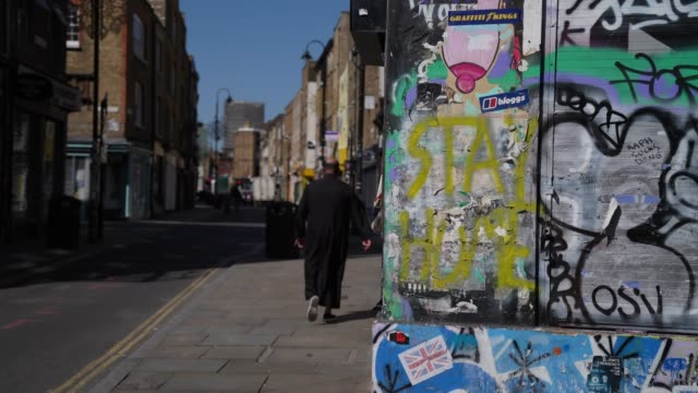 stockvideo's en b-roll-footage met piece coronavirus covid-19 themed street art graffiti saying stay home is pictured in east london on april 20 during the coronavirus covid-19... - eastenders