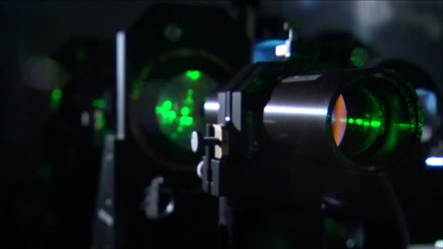 a piece of equipment beams a laser light. - laser stock videos & royalty-free footage