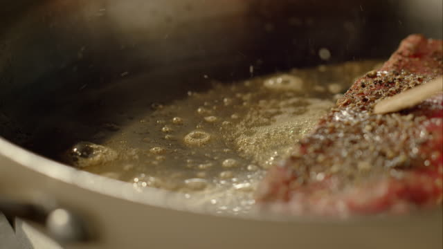 piece of meat frying in the pan - pan greek god stock videos & royalty-free footage
